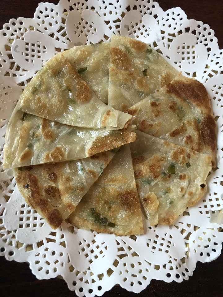 Photo - Scallion pancakes from Chuanyu Fusion in Oklahoma City. [Dave Cathey/The Oklahoman]