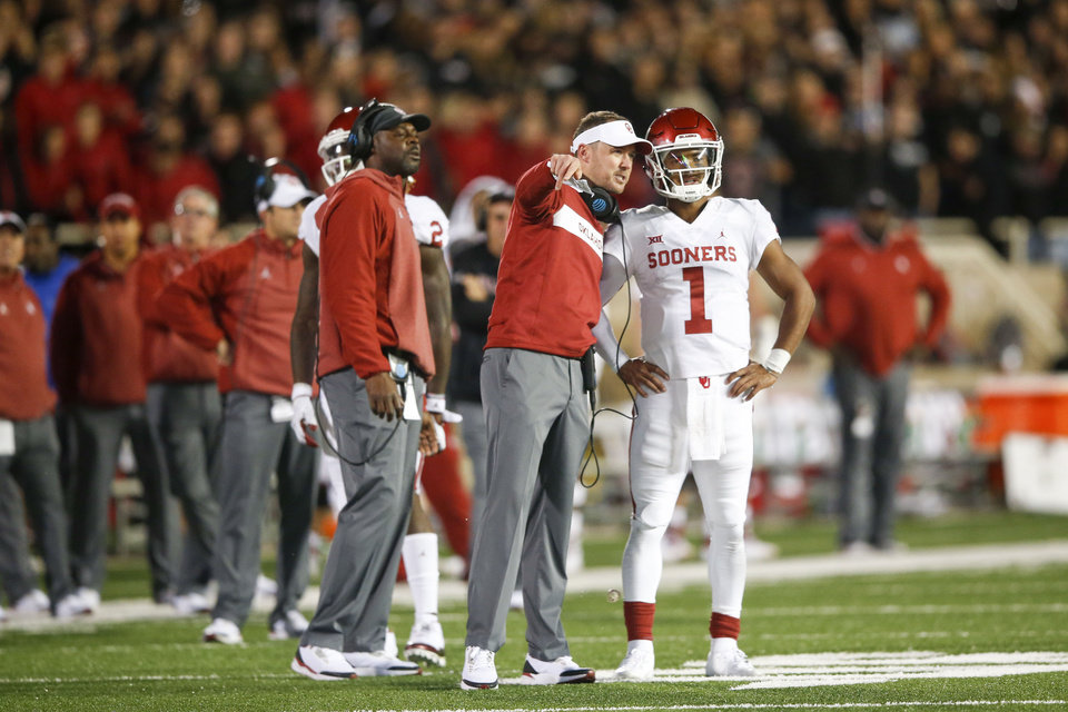 Photo - Oklahoma Sooners head coach Lincoln Riley  talks to Oklahoma Sooners quarterback Kyler Murray (1) during the NCAA football game between the Texas Tech Red Raiders and the Oklahoma Sooners at Jones AT&T Stadium in Lubbock, Texas on Saturday, November 03, 2018. IAN MAULE/Tulsa World