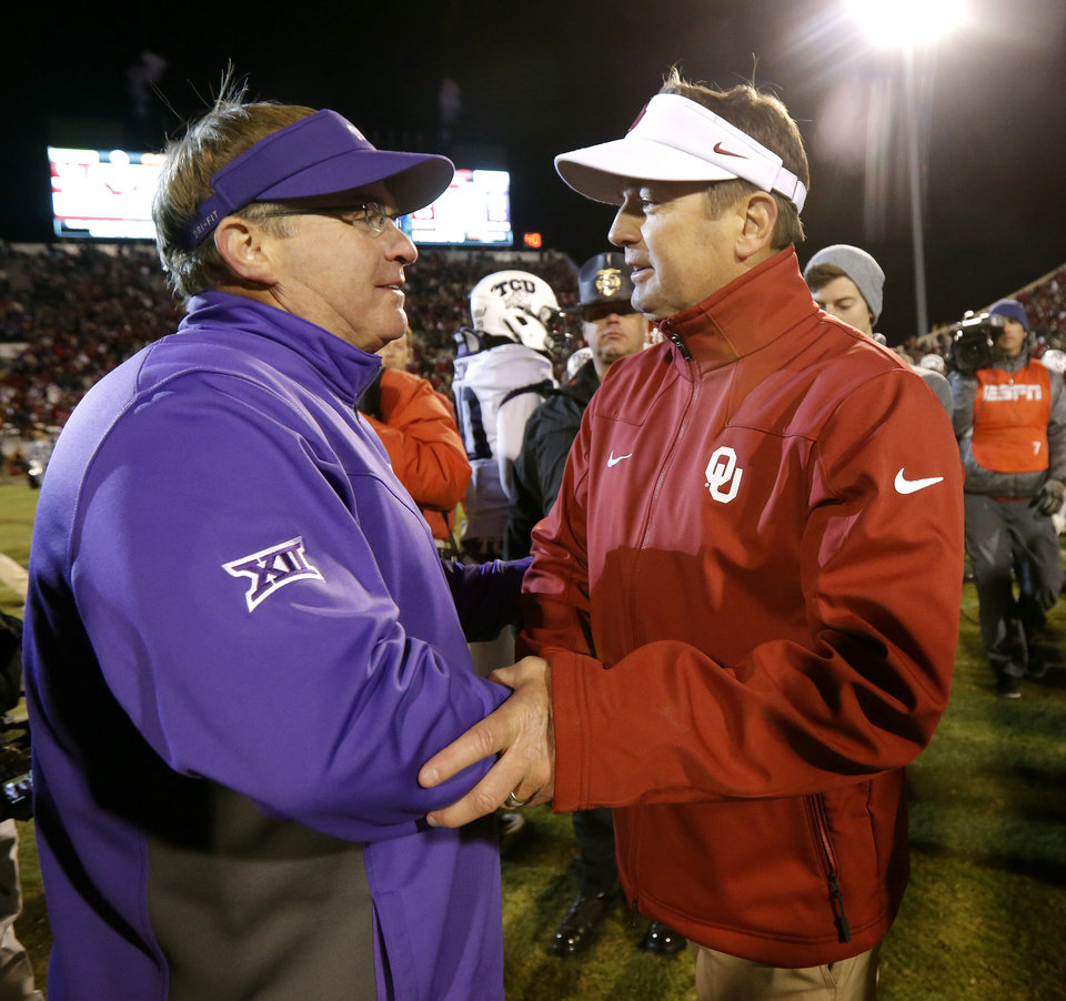 Photo - Oklahoma coach Bob Stoops meets with TCU coach Gary Patterson after a college football game between the University of Oklahoma Sooners (OU) and the TCU Horned Frogs at Gaylord Family-Oklahoma Memorial Stadium in Norman, Okla., on Saturday, Nov. 21, 2015. Oklahoma won 30-29. Photo by Bryan Terry, The Oklahoman