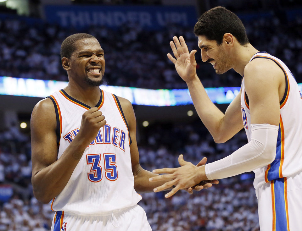 Photo - Oklahoma City's Kevin Durant (35) and Enes Kanter (11) celebrate after Durant was fouled going to the basket by San Antonio's David West (30), not pictured, in the fourth quarter during Game 4 of the Western Conference semifinals between the Oklahoma City Thunder and the San Antonio Spurs in the NBA playoffs at Chesapeake Energy Arena in Oklahoma City, Sunday, May 8, 2016. Oklahoma City won 111-97. Photo by Nate Billings, The Oklahoman