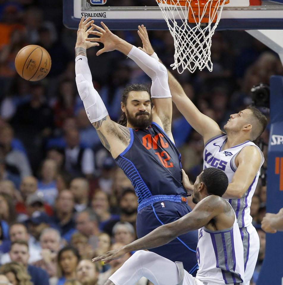 Photo - Steven Adams (12) reaches for the ball beside Sacramento's Nemanja Bjelica (88) during an NBA basketball game between the Oklahoma City Thunder and the Sacramento Kings at Chesapeake Energy Arena in Oklahoma City, Sunday, Oct. 21, 2018. Photo by Bryan Terry, The Oklahoman
