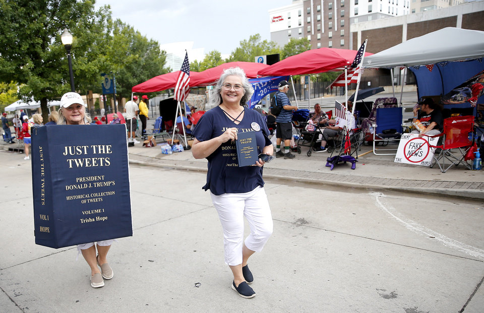 Photo - Trisha Hope, right, and Judy Wyegaard, of Houston, Texas, walk in downtown Tulsa, Okla., where Trump supporters are camping ahead of President Donald Trump's Saturday campaign rally, Friday, June 19, 2020. [Sarah Phipps/The Oklahoman]