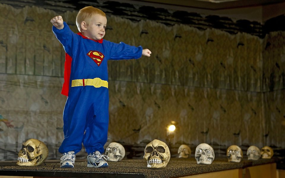 Photo - Superman costume modeled by Chase. Photo by Chris Landsberger, The Oklahoman.  CHRIS LANDSBERGER