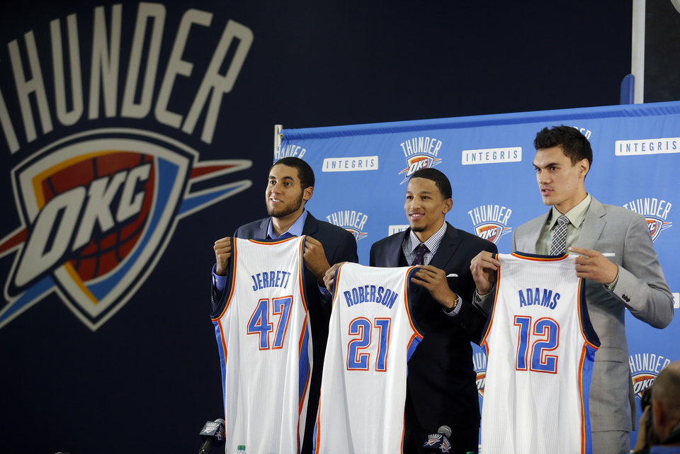 Photo - Grant Jerrett, Andre Roberson and Steven Adams hold their jerseys during a press conference at the Thunder Events center, Saturday, July 29, 2013. Photo by Sarah Phipps, The Oklahoman