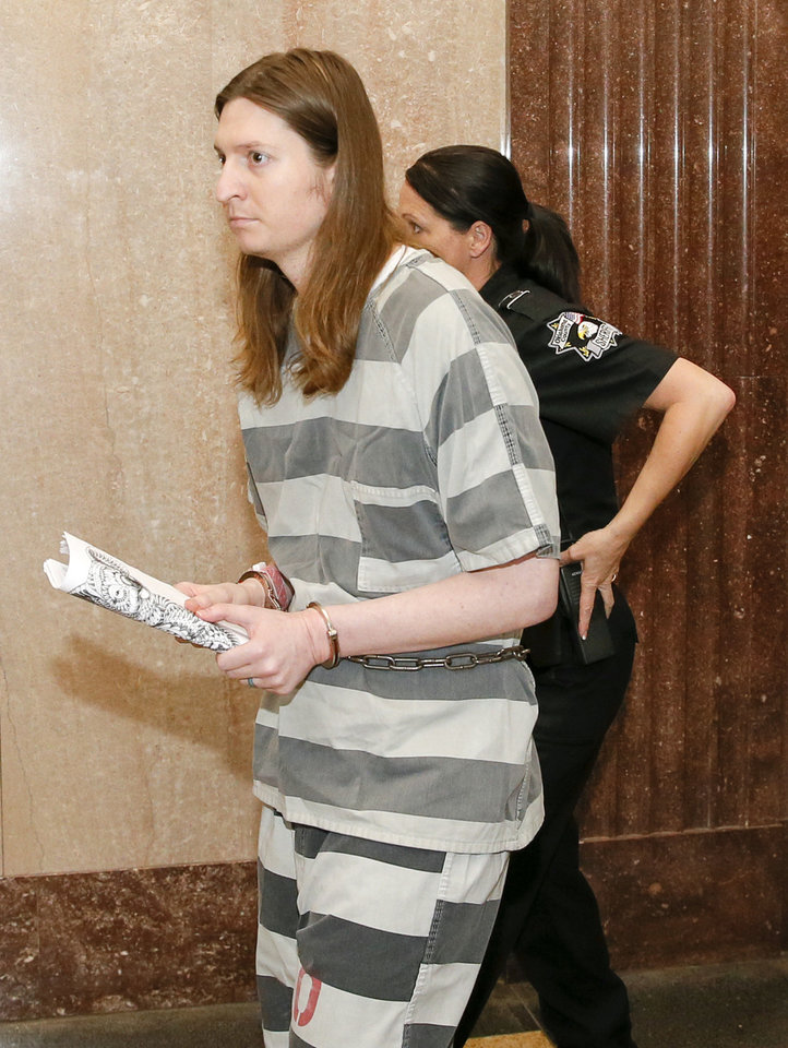 Photo -  Christian Erin Costello arrives at the courtroom Wednesday before being found not guilty by reason of insanity in his father's killing. [Photo by Nate Billings, The Oklahoman]