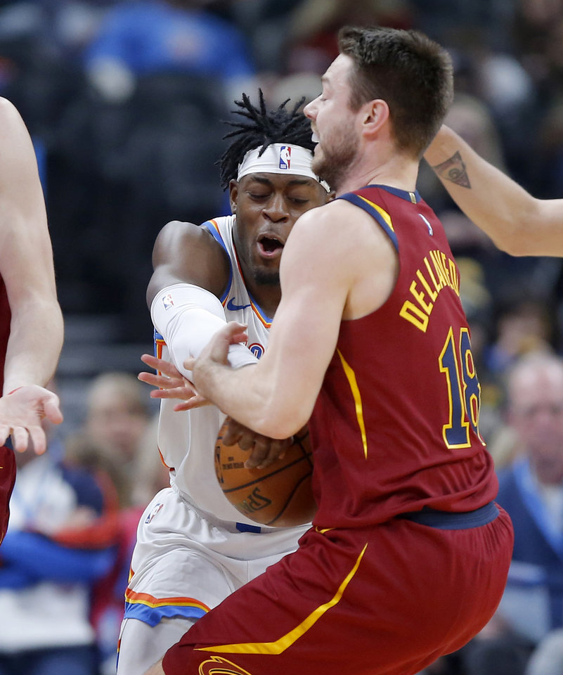 Photo - Oklahoma City's Luguentz Dort (5) takes the ball from Cleveland's Matthew Dellavedova (18) during an NBA basketball game between the Oklahoma City Thunder and the Cleveland Cavaliers at Chesapeake Energy Arena in Oklahoma City, Wednesday, Feb. 5, 2020. [Bryan Terry/The Oklahoman]