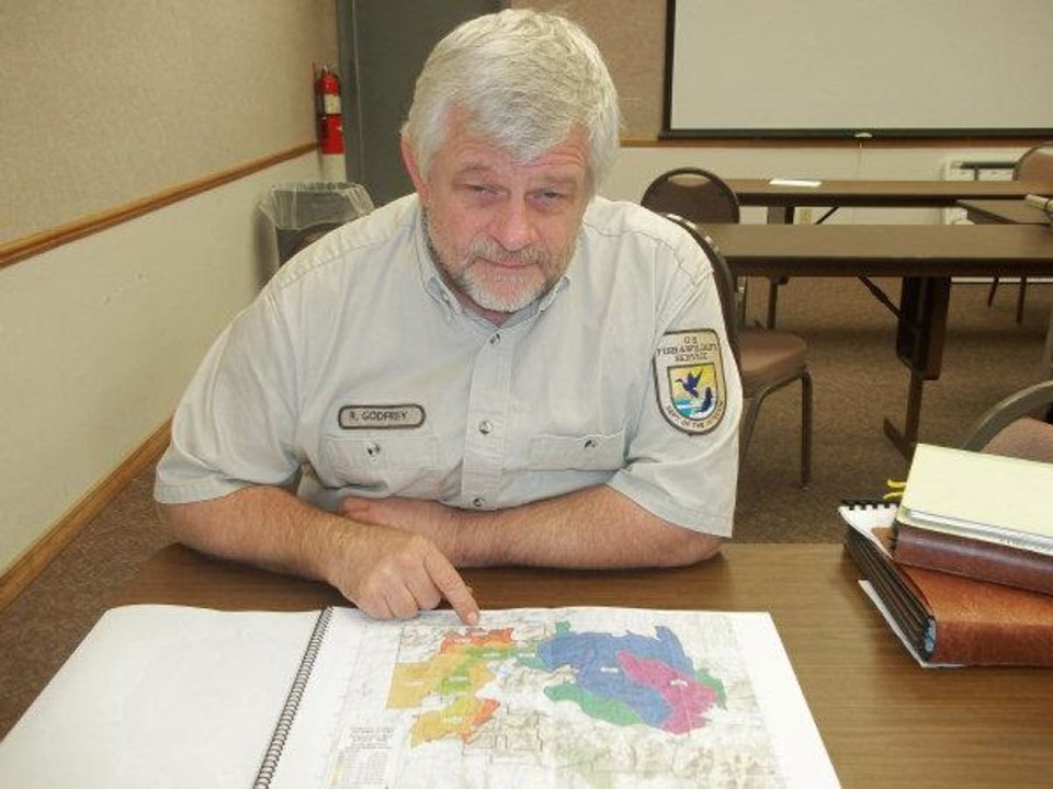 Photo - RECOVER / RECOVERY: Ralph Godfrey, the fire management officer at the refuge looks over a map. Wichita Wildlife Refuge is recovering from the wildfires of the summer. P HOTO BY RON J. JACKSON, JR., FOR THE OKLAHOMAN