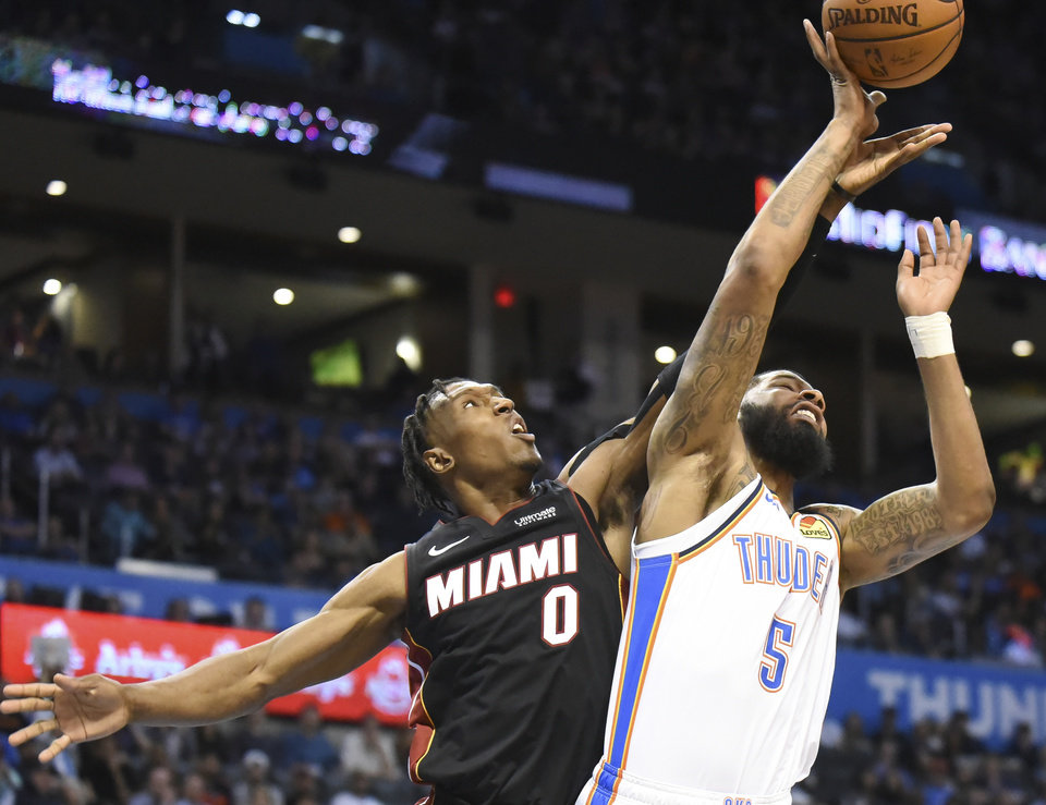 Photo - Oklahoma City Thunder forward Markieff Morris (5) shoots over Miami Heat guard Josh Richardson (0) in the second half of an NBA basketball game, Monday, March 18, 2019, in Oklahoma City. (AP Photo/Kyle Phillips)