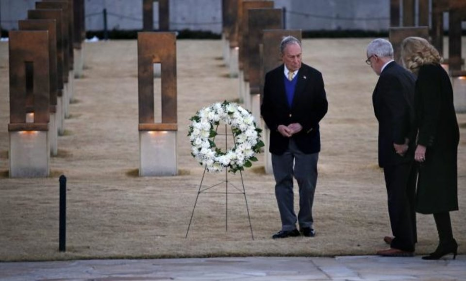 Photo -  Democratic presidential candidate Mike Bloomberg places a wreath, accompanied by former Gov. Brad Henry and his wife, Kim, at the Oklahoma City National Memorial & Museum on Feb. 8. [Sarah Phipps/The Oklahoman]