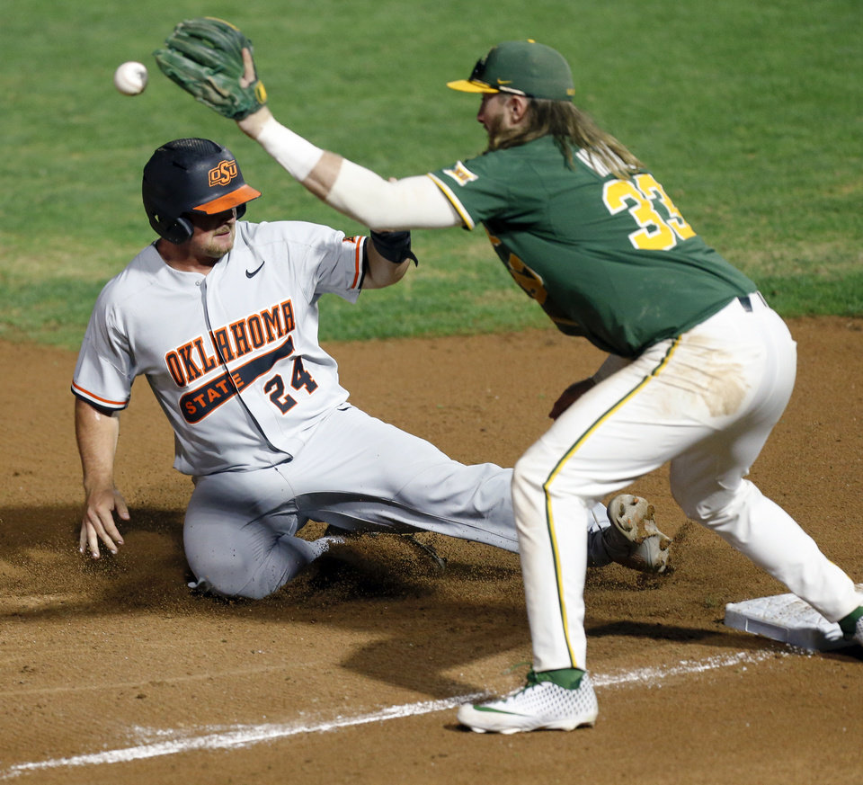 Photo - OSU's Colin Simpson (24) slides safely into third base as Baylor's Davis Wendzel (33) catches the ball in the fourth inning during a game between Oklahoma State (OSU) and Baylor in the Big 12 baseball tournament at the Chickasaw Bricktown Ballpark in Oklahoma City, Thursday, May 23, 2019. [Nate Billings/The Oklahoman]