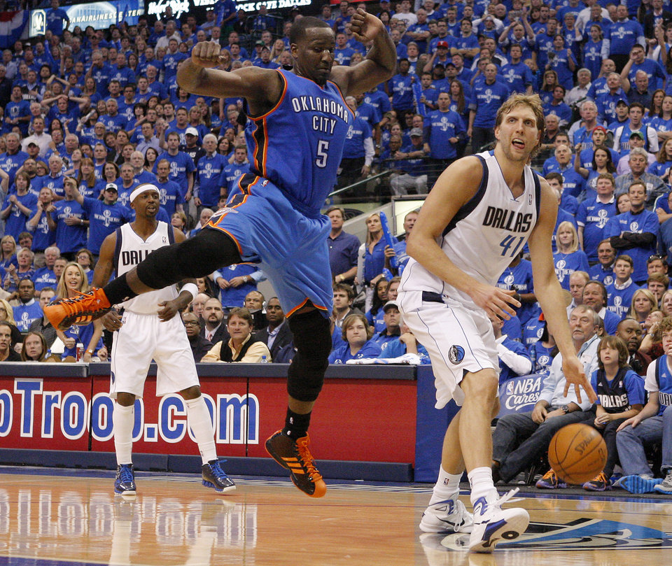 Photo - Oklahoma City's Kendrick Perkins (5) tries to defend Dirk Nowitzki (41) of Dallas during game 1 of the Western Conference Finals in the NBA basketball playoffs between the Dallas Mavericks and the Oklahoma City Thunder at American Airlines Center in Dallas, Tuesday, May 17, 2011. Photo by Bryan Terry, The Oklahoman