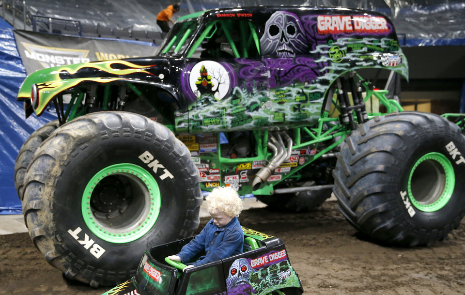 Photo - Ryker Ammons, 4, of Yukon, Okla., sits in his own Grave Digger truck during a special meet and greet at Chesapeake Energy Arena in Oklahoma City, Friday, Feb. 14, 2020.  [Sarah Phipps/The Oklahoman]