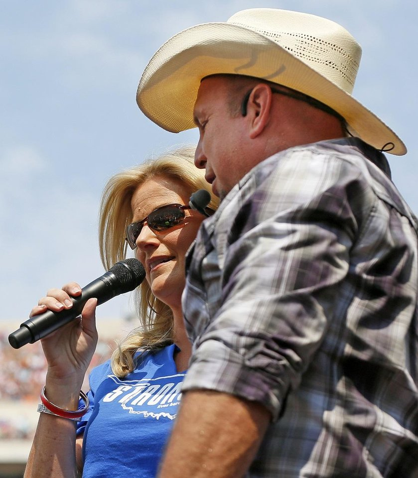 Photo - Trisha Yearwood and Garth Brooks perform during the Oklahoma Twister Relief Concert, benefiting victims of the May tornadoes, at Gaylord Family - Oklahoma Memorial Stadium on the campus of the University of Oklahoma in Norman, Okla., Saturday, July 6, 2013. [The Oklahoman Archives]