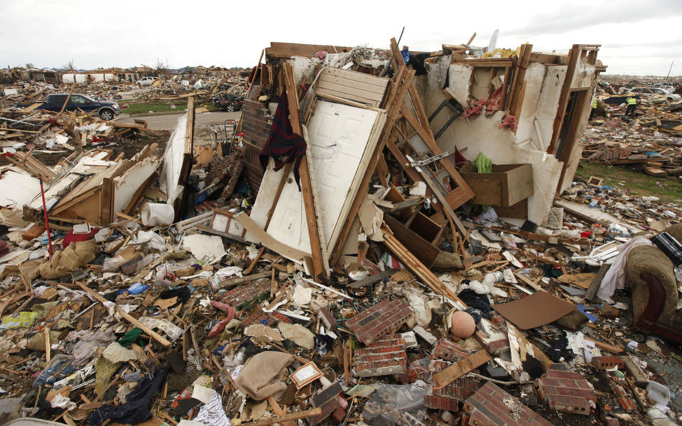 Photo - An above ground safe room under the rubble of this destroyed home in Moore, OK, is still standing after taking the impact of May 20th's EF5 tornado. Thursday, May 30, 2013,  Photo by Paul Hellstern, The Oklahoman  PAUL HELLSTERN