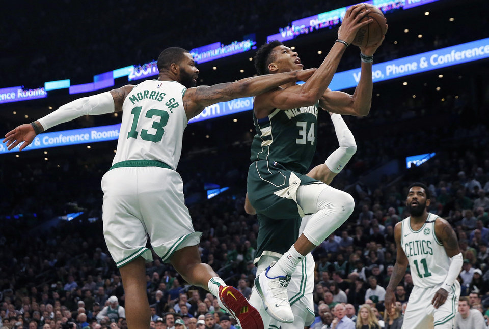 Photo - Milwaukee Bucks' Giannis Antetokounmpo (34) shoots against Boston Celtics' Marcus Morris (13) during the first half of Game 4 of a second-round NBA basketball playoff series in Boston, Monday, May 6, 2019. (AP Photo/Michael Dwyer)