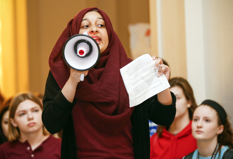 Photo - Kulsoom Ghias, an Edmond Memorial High School sophomore, speaks at a rally led by students on the second floor of the state Capitol during the eighth day of a walkout by Oklahoma teachers, in Oklahoma City, Monday, April 9, 2018. Photo by Nate Billings, The Oklahoman