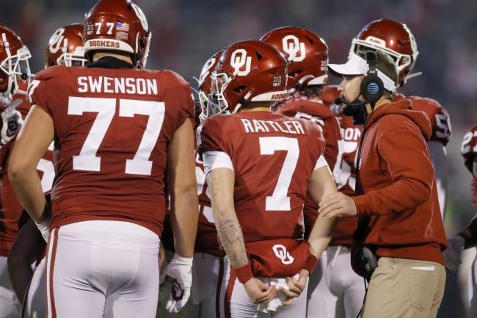 Photo -  Oklahoma coach Lincoln Riley stands beside Oklahoma's Spencer Rattler, middle, and Erik Swenson, left, during Bedlam. [Bryan Terry/The Oklahoman]