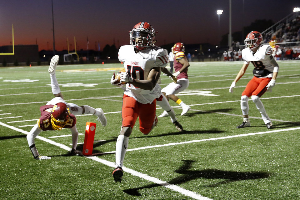 Photo - Mustang's Khary Brown scores a touchdown during a high school football game between Putnam City North and Mustang in Oklahoma City, Friday, Nov. 1, 2019.  [Bryan Terry/The Oklahoman]