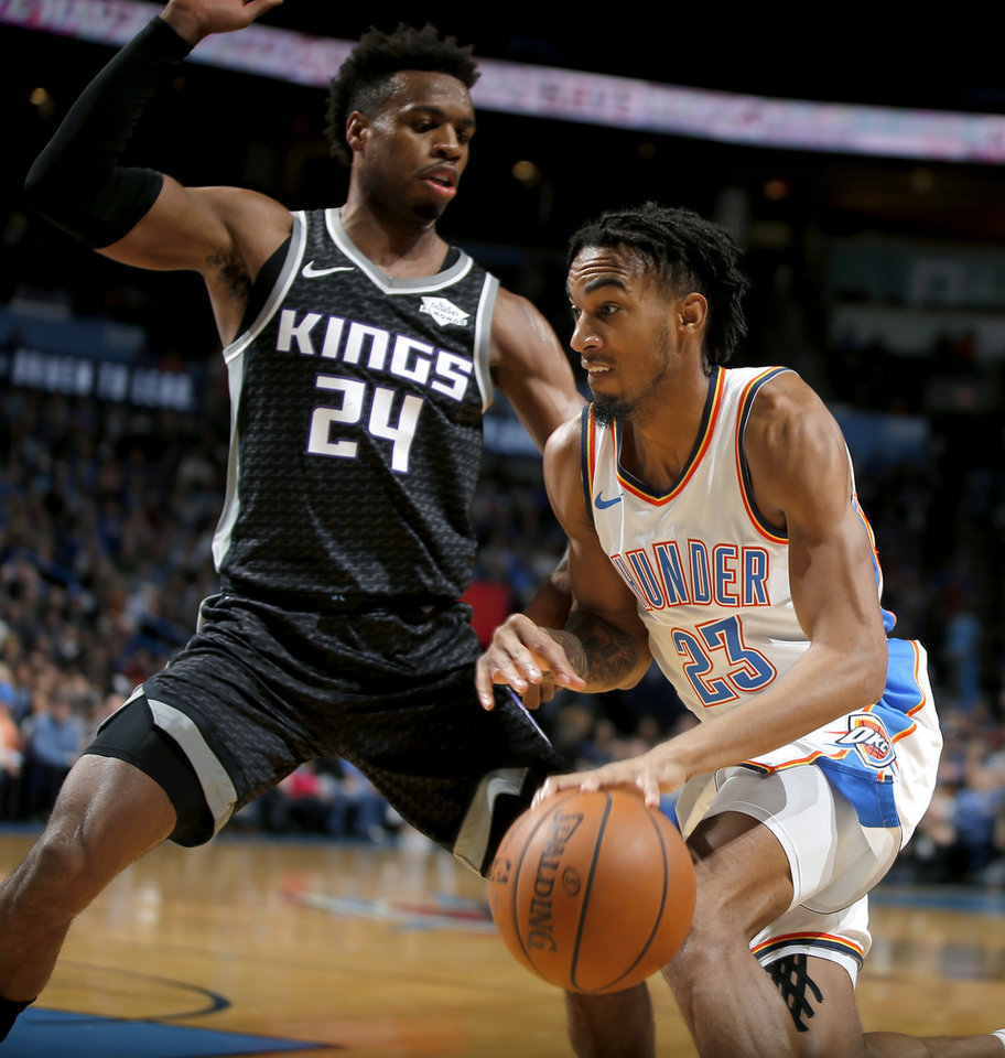 Photo - Oklahoma City's Terrance Ferguson (23) tries to get past Sacramento's Buddy Hield (24) during an NBA basketball game between the Oklahoma City Thunder and the Sacramento Kings at Chesapeake Energy Arena in Oklahoma CIty, Saturday, Feb. 23, 2019. Photo by Bryan Terry, The Oklahoman