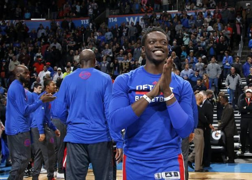 Photo - Detroit's Reggie Jackson smiles after his introduction before an NBA basketball game between the Oklahoma City Thunder and the Detroit Pistons at Chesapeake Energy Arena on Friday, Nov. 27, 2015. Oklahoma City won 103-81. Photo by Bryan Terry, The Oklahoman