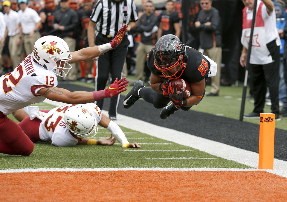 Photo -  Oklahoma State's Landon Wolf (88) dives in for a touchdown as Iowa State's Greg Eisworth (12) and Braxton Lewis (33) defend in the second quarter between the Cowboys and Cyclones. Wolf announced on Twitter on Monday his decision to leave as a graduate transfer. [Sarah Phipps, The Oklahoman]