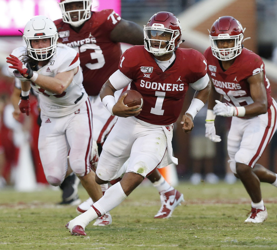 Photo - Oklahoma's Jalen Hurts (1) carries the ball in the second quarter during a college football game between the Oklahoma Sooners (OU) and South Dakota Coyotes at Gaylord Family - Oklahoma Memorial Stadium in Norman, Okla., Saturday, Sept. 7, 2019. [Nate Billings/The Oklahoman]