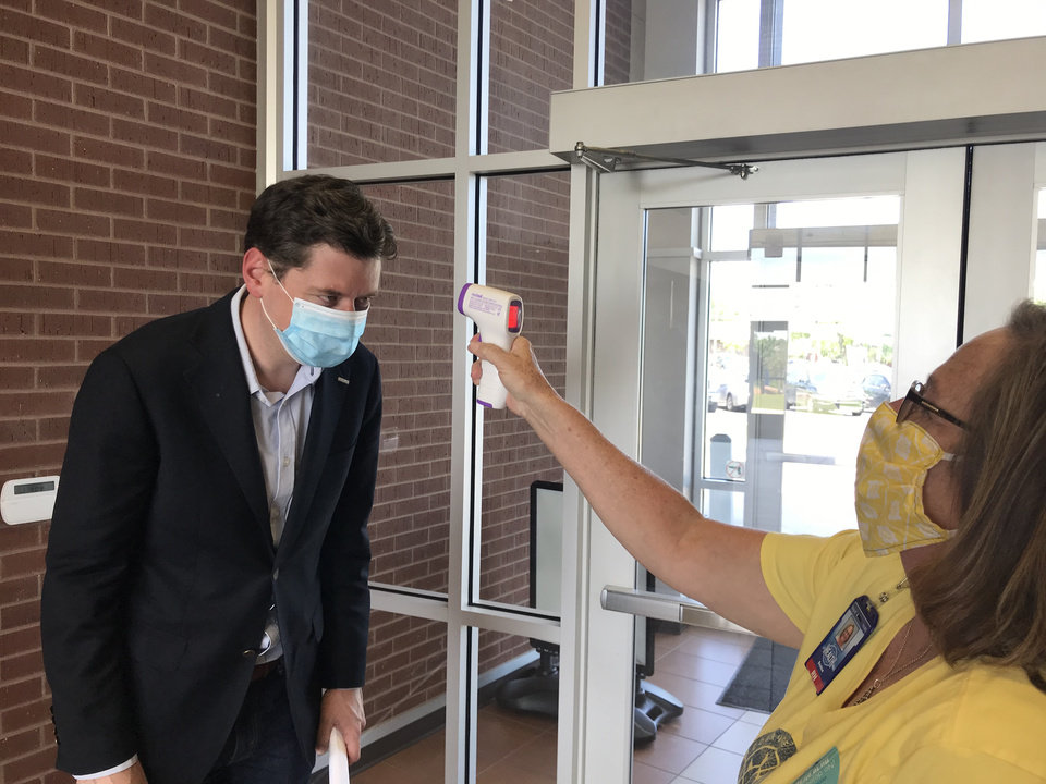 Photo - The Oklahoma City Council extended the city's mask ordinance until Dec. 7. Mayor David Holt arrived for a COVID-19 news conference earlier this year. [The Oklahoman Archive]