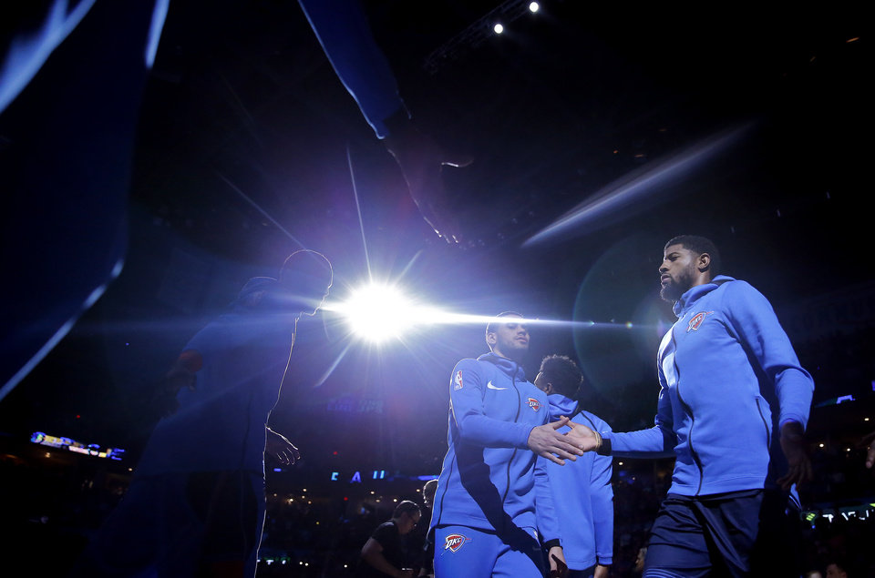 Photo - Oklahoma City's Paul George (13) is introduced before the NBA basketball game between the Oklahoma City Thunder and Houston Rockets at the Chesapeake Energy Arena, Tuesday, April 9, 2019. Photo by Sarah Phipps, The Oklahoman