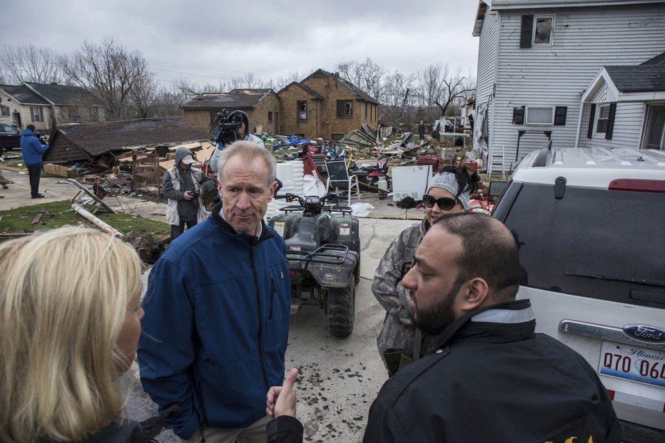 Photo - Illinois Gov. Bruce Rauner talks with residents in Naplate, Ill., on Wednesday, March 1, 2017, as he tours tornado damage in the village. Communities across Illinois are cleaning up after deadly storms producing tornadoes moved through much of the Midwest. (Zbigniew Bzdak/Chicago Tribune via AP)