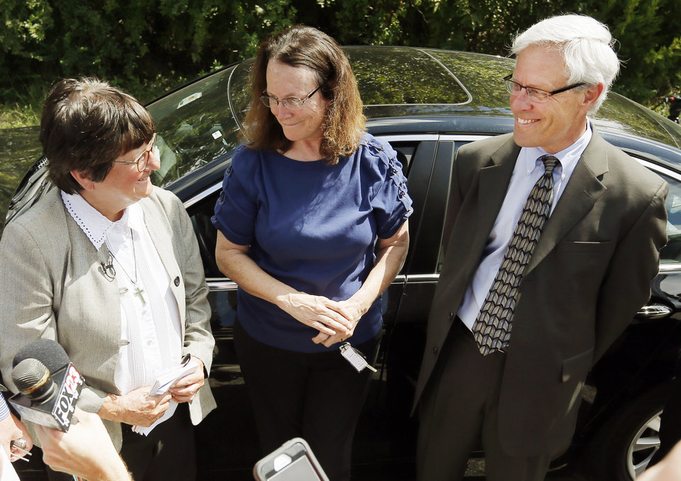 Photo - From left, Sister Helen Prejean, Kathleen Lord and Don Knight smile as they speak to the press after a two-week stay of execution was announced for Richard Eugene Glossip, outside the Oklahoma State Penitentiary in McAlester, Okla., Wednesday, Sept. 16, 2015. Prejean is an advocate for Glossip's innocence. Lord and Knight are from Glossip's legal team. Photo by Nate Billings, The Oklahoman
