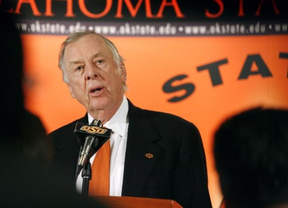 Photo -  Boone Pickens speaks at the announcement of his $165 million gift to Oklahoma State's athletic department Jan. 10, 2005, in Stillwater. [Steve Sisney/Oklahoman archives]