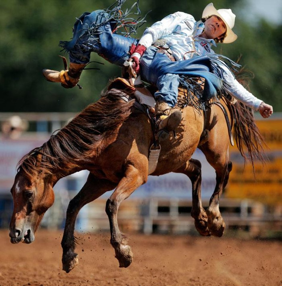 "Photo -  James ""Colt"" Kitaif of Tylertown, Mississippi, competes in bareback bronc during the final round of the International Finals Youth Rodeo (IFYR) in Shawnee, Okla., Saturday, July 17, 2010. Photo by Nate Billings, The Oklahoman"