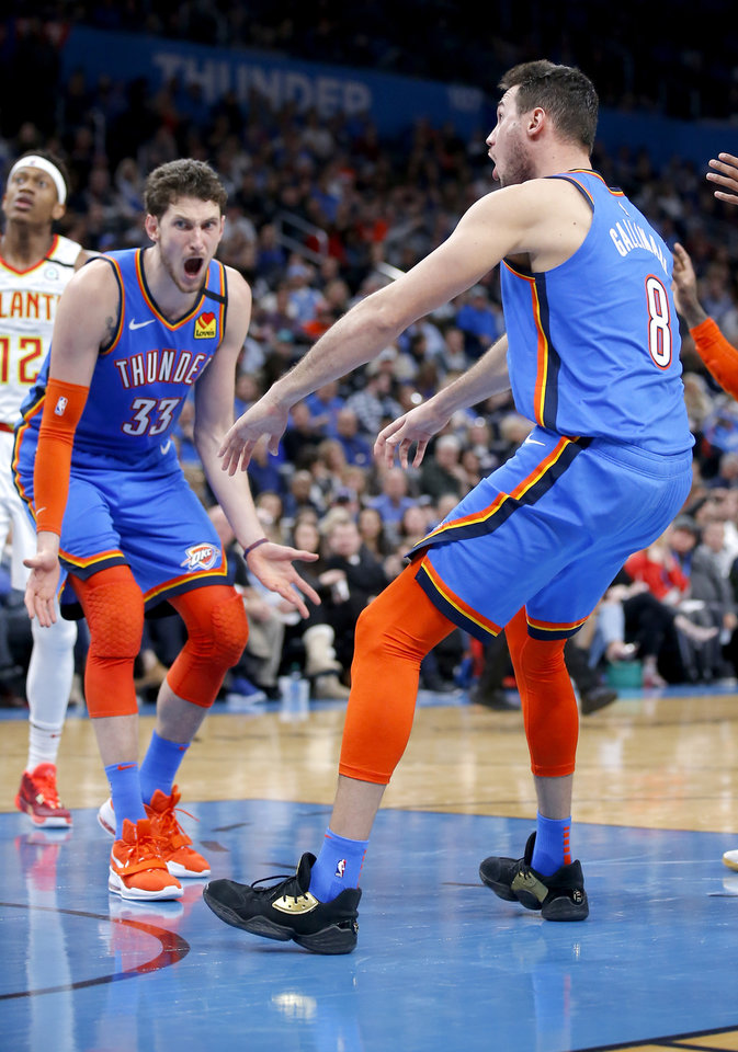 Photo - Oklahoma City's Danilo Gallinari (8) and Mike Muscala (33) react after a play during the NBA basketball game between the Oklahoma City Thunder and the Atlanta Hawks at the Chesapeake Energy Arena in Oklahoma City,Friday, Jan. 24, 2020.  [Sarah Phipps/The Oklahoman]