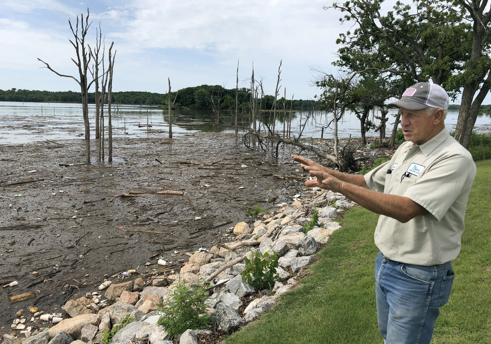 Photo -  Leon Mixer stressed the magnitude of the problem of trash at Arcadia Lake. He is tired of the blame being put on his maintenance staff, Mixer said. [Photo by Kelsy Schlotthauer, The Oklahoman]