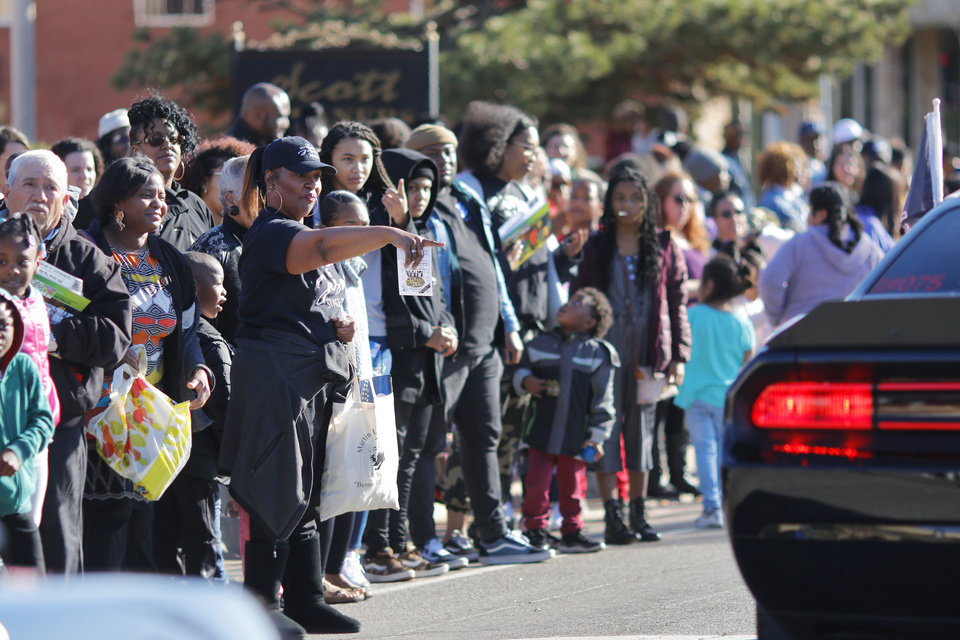 Photo - The crowd reacts as a car club goes by at the MLK Day Parade during celebration of Dr. Martin Luther King, Jr. holiday, Monday, January 20, 2019. [Photo by Doug Hoke/The Oklahoman]