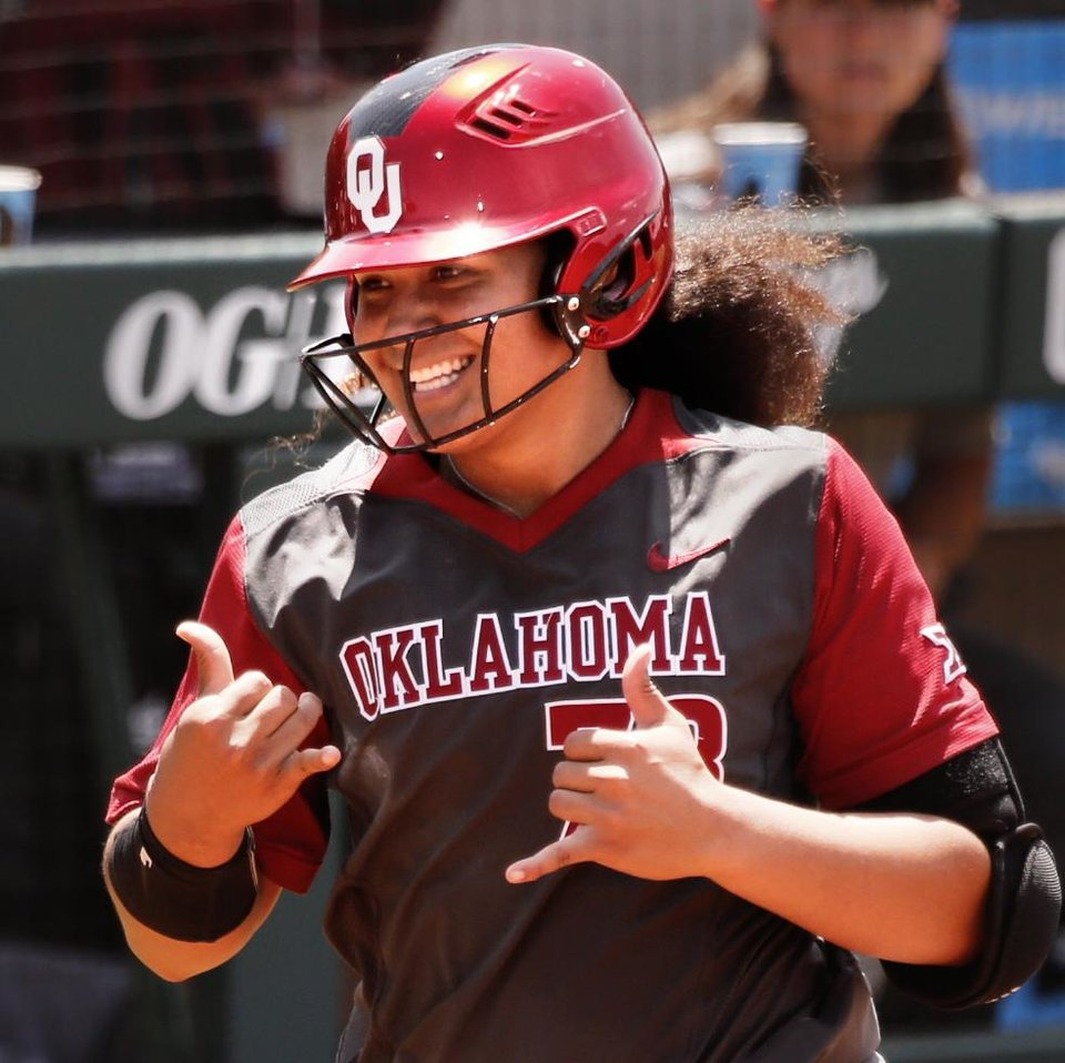 Photo - Jocelyn Alo comes home following a home run during the 2018 NCAA Championships Norman Super Regional Softball Game 2 where the University of Oklahoma Sooners (OU) defeated the Arkansas Razorbacks 9-0 at Marita Hynes Field at the OU Softball Complex on Saturday, May 26, 2018 in Norman, Okla.  Photo by Steve Sisney, The Oklahoman