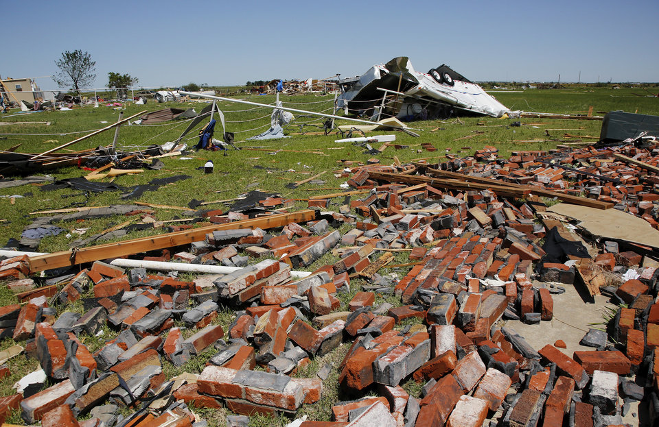 Photo - Brick from a destroyed house in Union City are spread across the lawn  on Saturday, June 1, 2013.     Photo  by Jim Beckel, The Oklahoman.