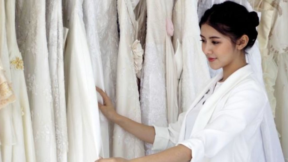 Photo -  A professional may have a dress in mind that fits none of your listed specifications but ends up being your favorite, experts say. [Photo provided]
