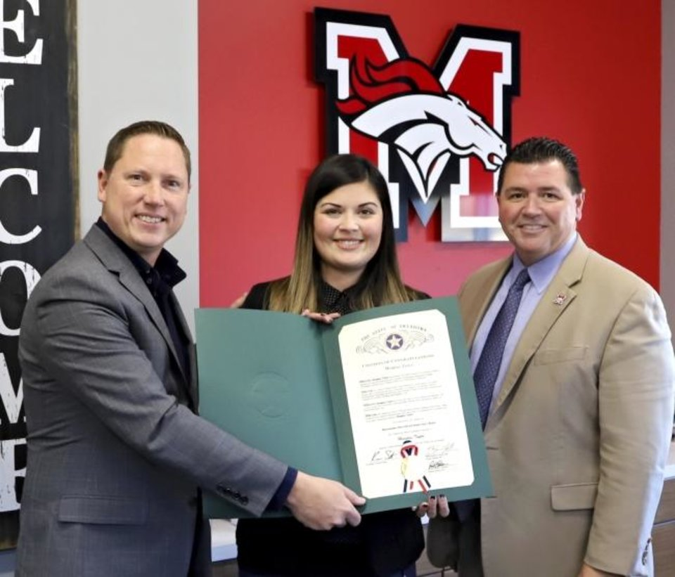 Photo -  Meaghan Taylor, a teacher at Meadow Brook Intermediate School in Mustang, is presented with a citation by state Rep. Brian Hill. Pictured at right is Mustang Public Schools Superintendent Charles Bradley. [PHOTO PROVIDED]