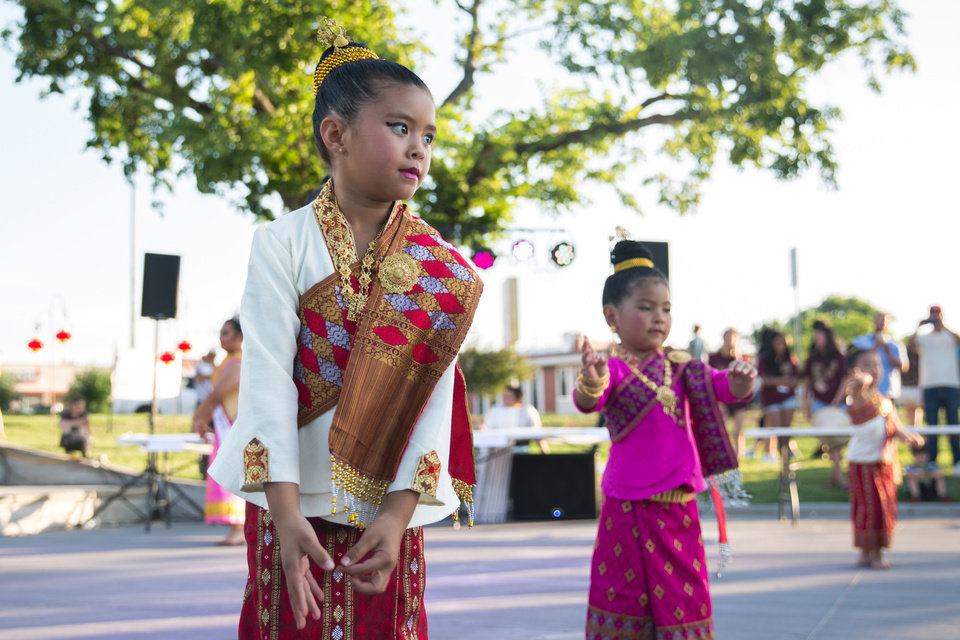 Berkeley Gilmore dances with her group Lao Natasinh, performing dances from Lao in traditional clothing, at the first Asian Night Market Saturday, June 9, 2018. The event was created for people with Asian heritage to honor their roots and educate the community about the various cultures within the Asian community. Photo by Anya Magnuson, The Oklahoman