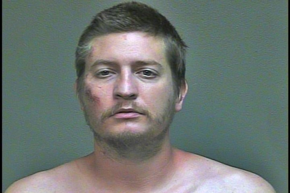 Photo -  Christian Costello at his Oklahoma County jail booking Sunday night.