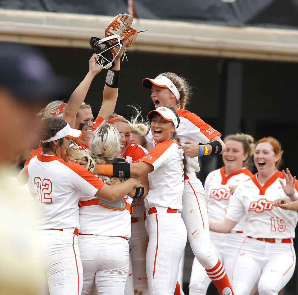 Photo -  Oklahoma State's softball team celebrates after winning the Stillwater Regional on Saturday. OSU beat Tulsa 2-1 at Cowgirl Stadium. [Bryan Terry/The Oklahoman]