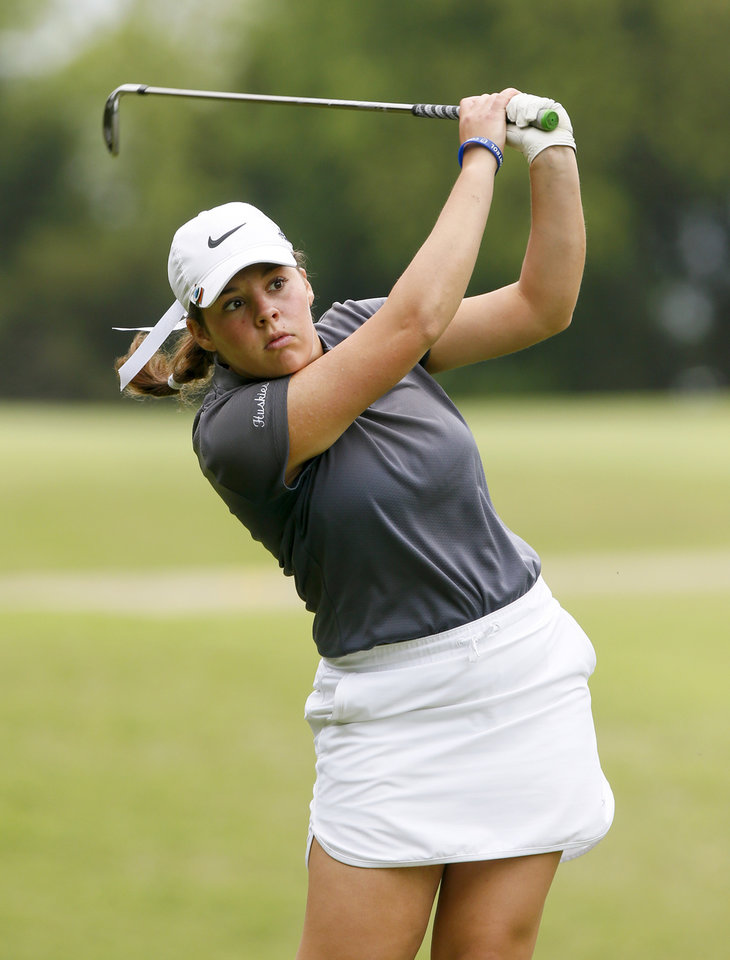 Photo - Edmond North's Emily Miller follows through on a shot during the first day of the Class 6A girls high school golf state championship at Earlywine Golf Club in Oklahoma City, Wednesday, May 1, 2019. [Nate Billings/The Oklahoman]