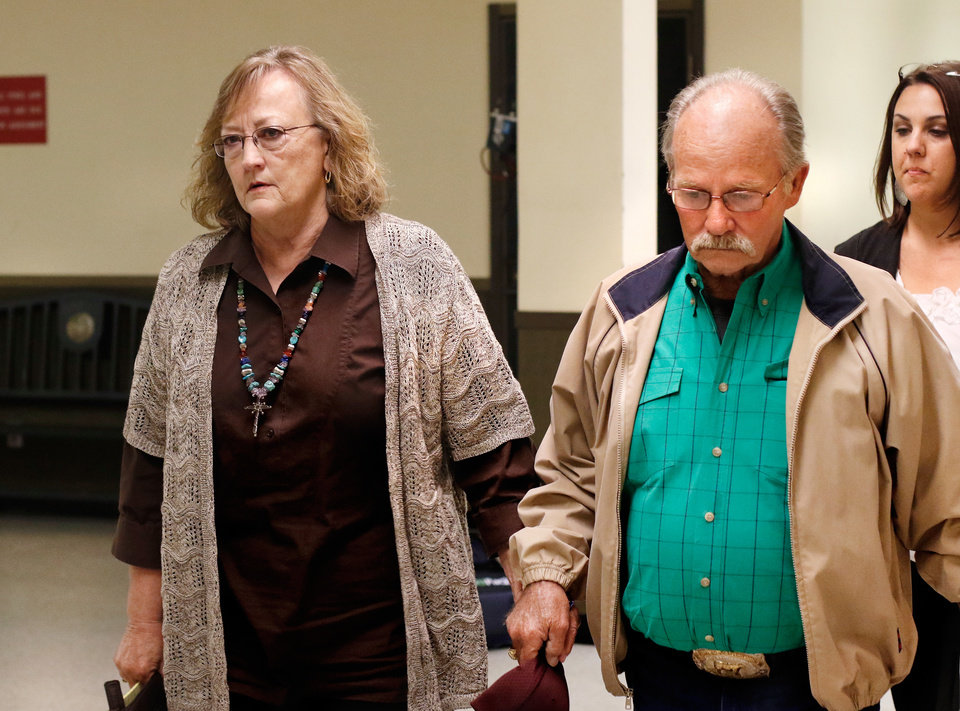 Photo - Appearing solemn, the parents of victim  Tinker Hruby leave the courtroom after their grandson Alan Hruby was sentenced to three life terms in prison.  Murder defendant Alan J. Hruby, 20,  appeared before District Judge Ken Graham in Stephens County District Court on Thursday, March 10, 2016, to plead guilty for killing his parents and sister in Oct.  2014, at the family home in Duncan, Okla.  He was a freshman at the University of Oklahoma at the time of the murders. Stephens County District Attorney Jason Hicks accepted the plea agreement in which Alan agreed to accept three consecutive life sentences without parole. The defendant's father, John Hruby, mother, Tinker Hruby and sister, Katherine Hruby, died of gunshot wounds. Photo by Jim Beckel, The Oklahoman.