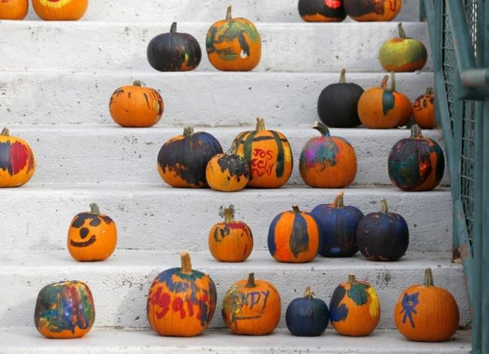 Photo -  Painted pumpkins dry in Bricktown in Oklahoma City in 2016. [Sarah Phipps/The Oklahoman Archives]