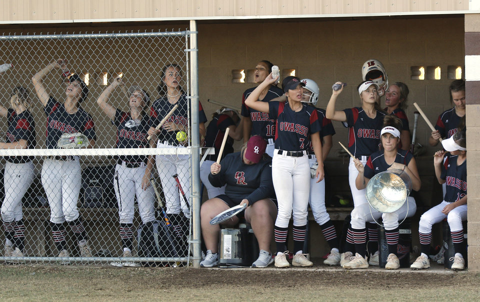 Photo - Owasso dugout cheers while at bat during the 6A Fast Pitch Championship game between Edmond Memorial and Owasso at the Ball Fields at Firelake in Shawnee, Saturday, October 19, 2019. [Doug Hoke/The Oklahoman]