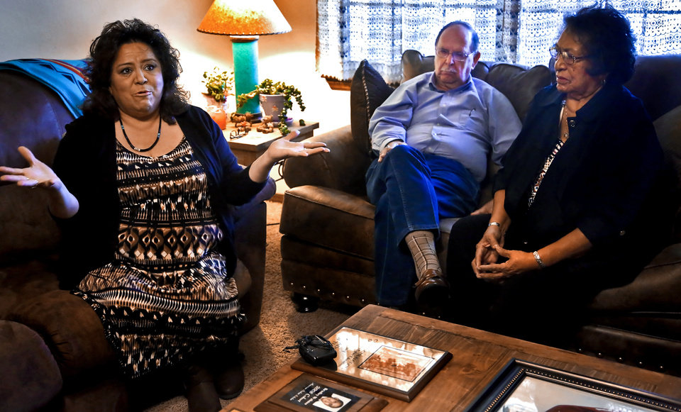 Photo - Kari Wahnee, left,  speaks about the death of her son Brad while her parents Rev. William and Geneva Foote listen on Monday, Jan. 25, 2016, in Lawton, Okla. Wahnee, who was 19 at the time, was killed in an unsolved drive by shooting on Sept. 22, 2009 near NW 30th and May Ave. in Oklahoma City. Photo by Chris Landsberger, The Oklahoman