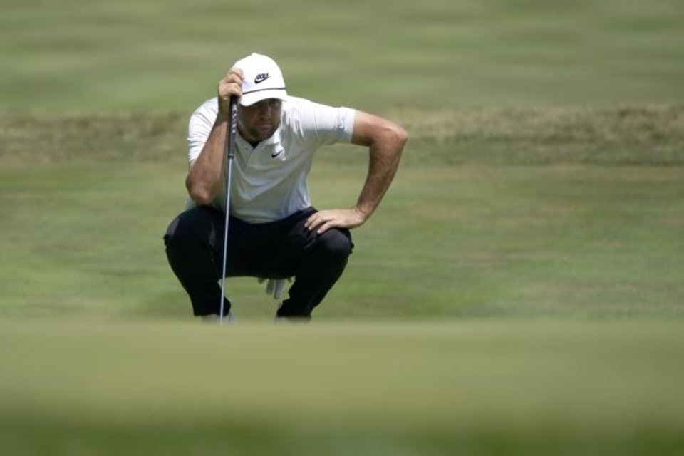 Photo -  Scottie Scheffler prepares to putt on the 14th green during the second round of the Northern Trust golf tournament at TPC Boston on Friday in Norton, Mass. [AP Photo/Charles Krupa]