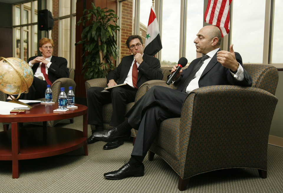 Photo - Imad Moustapha (right), Syrian ambassador to the United States, joins a panel discussion on U.S-Syrian relations, Lebanon, Iraq, and Israel at the University of Oklahoma on Wednesday, Oct. 17, 2007, in Norman, Okla.  Other panel members are OU faculty members Josh Landis (left) and Zach Messitte (center).  By STEVE SISNEY, The Oklahoman  ORG XMIT: KOD