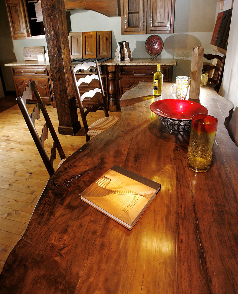 A Table Set Made From A Naturally Downed Tree And Cabinets Made From Used  Wood Are